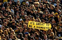Crowd of students holding sign, It's Great to be a Hawkeye